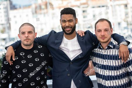 Damien Bonnard, Djebril Zonga, Alexis Manenti. Actors Damien Bonnard, from left, Djebril Zonga and Alexis Manenti pose for photographers at the photo call for the film 'Les Miserables' at the 72nd international film festival, Cannes, southern France