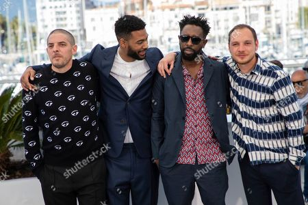 Damien Bonnard, Djebril Zonga, Ladj Ly, Alexis Manenti. Actors Damien Bonnard, from left, Djebril Zonga, director Ladj Ly and actor Alexis Manenti pose for photographers at the photo call for the film 'Les Miserables' at the 72nd international film festival, Cannes, southern France