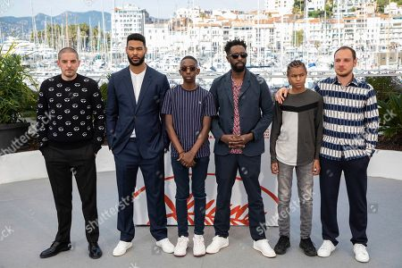 Damien Bonnard, Djebril Didier Zonga, Al Hassan Ly, Ladj Ly, Issa Perica, Alexis Manenti. Actors Damien Bonnard, from left, Djebril Didier Zonga, Al Hassan Ly, director Ladj Ly, actors Issa Perica and Alexis Manenti pose for photographers at the photo call for the film 'Les Miserables' at the 72nd international film festival, Cannes, southern France