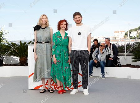 Russian actress Victoria Miroshnichenko, Russian actress Vasilisa Perelygina and Russian director Kantemir Balagov pose during the photocall for 'Beanpole' at the 72nd annual Cannes Film Festival, in Cannes, France, XX May 2019. The movie is presented in the section Un Certain Regard of the festival which runs from 14 to 25 May.