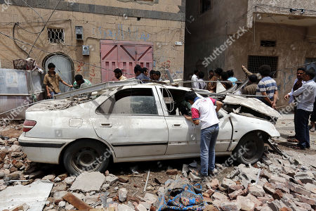 Yemenis inspect the site of their destroyed house, after the Saudi-led airstrike at a neighborhood in Sana?a, Yemen, 16 May 2019. According to media reports, the Saudi-led military coalition intensified its airstrikes on the Yemeni capital Sana?a by targeting several positions and killing at least six Yemenis and wounding at least 52 others, in retaliation after the Iranian-aligned movement in Yemen allegedly attacked Saudi and Emirates oil ships.
