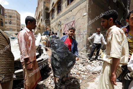 A Yemeni man carries his luggage after his house was destroyed due to a Saudi-led airstrike at a neighborhood in Sana?a, Yemen, 16 May 2019. According to media reports, the Saudi-led military coalition intensified its airstrikes on the Yemeni capital Sana?a by targeting several positions and killing at least six Yemenis and wounding at least 52 others, in retaliation after the Iranian-aligned movement in Yemen allegedly attacked Saudi and Emirates oil ships.