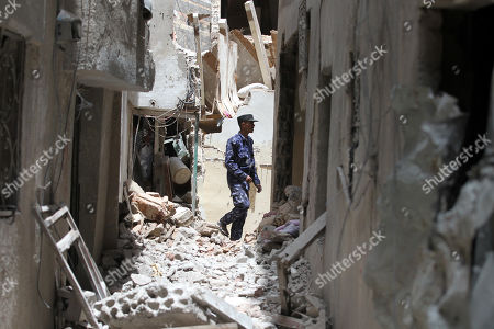 A Yemeni soldier inspects the site of a destroyed house, after the Saudi-led airstrike at a neighborhood in Sana?a, Yemen, 16 May 2019. According to media reports, the Saudi-led military coalition intensified its airstrikes on the Yemeni capital Sana?a by targeting several positions and killing at least six Yemenis and wounding at least 52 others, in retaliation after the Iranian-aligned movement in Yemen allegedly attacked Saudi and Emirates oil ships.