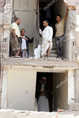 Yemenis inspect the rubble of their destroyed house, damaged after an airstrike at a neighborhood in Sana?a, Yemen, 16 May 2019. According to media reports, the Saudi-led military coalition intensified its airstrikes on the Yemeni capital Sana?a by targeting several positions and neighborhoods, killing at least seven Yemenis and wounding at least 52 others, in retaliation after the Iranian-aligned movement in Yemen allegedly attacked Saudi and Emirates oil ships.