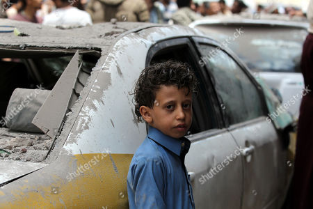 A Yemeni child stands near a destroyed car, after the Saudi-led airstrike at a neighborhood in Sana?a, Yemen, 16 May 2019. According to media reports, the Saudi-led military coalition intensified its airstrikes on the Yemeni capital Sana?a by targeting several positions and killing at least six Yemenis and wounding at least 52 others, in retaliation after the Iranian-aligned movement in Yemen allegedly attacked Saudi and Emirates oil ships.