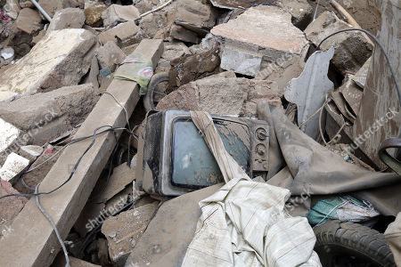 A broken TV is seen amongst debris of a destroyed building at the site of a Saudi-led airstrike at a neighborhood in Sana?a, Yemen, 16 May 2019. According to media reports, the Saudi-led military coalition intensified its airstrikes on the Yemeni capital Sana?a by targeting several positions and killing at least six Yemenis and wounding at least 52 others, in retaliation after the Iranian-aligned movement in Yemen allegedly attacked Saudi and Emirates oil ships.