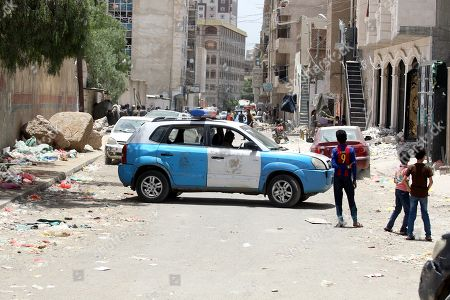 A police vehicle blocks a street leading to a destroyed building damaged after an airstrike at a neighborhood in Sana?a, Yemen, 16 May 2019. According to media reports, the Saudi-led military coalition intensified its airstrikes on the Yemeni capital Sana?a by targeting several positions and killing at least six Yemenis and wounding at least 52 others, in retaliation after the Iranian-aligned movement in Yemen allegedly attacked Saudi and Emirates oil ships.