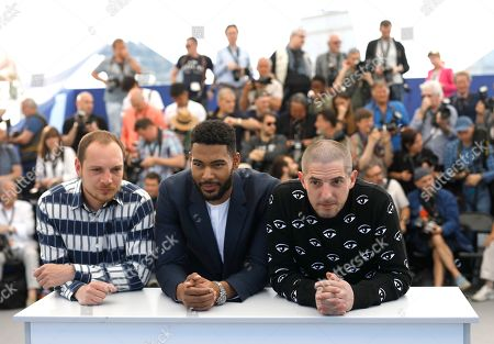 Djebril Zonga, Alexis Manenti, Damien Bonnard. Actors Alexis Manenti, from left, Djebril Zonga and Damien Bonnard pose for photographers at the photo call for the film 'Les Miserables' at the 72nd international film festival, Cannes, southern France