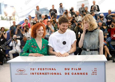 Victoria Miroshnichenko, Kantemir Balagov, Vasilisa Perelygina. Actress Victoria Miroshnichenko, from left, director Kantemir Balagov and actress Vasilisa Perelygina pose for photographers at the photo call for the film 'Beanpole' at the 72nd international film festival, Cannes, southern France