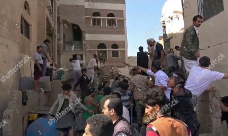 In this frame grab from from video, people search in the rubble following Saudi-led coalition airstrikes that killed at least six, including children, officials said, in the residential center of the capital, Sanaa, Yemen. The Sanaa airstrikes came after Yemen's Iran-backed Houthi rebels, who control the capital, launched a drone attack earlier in the week on a critical oil pipeline in Saudi Arabia, Tehran's biggest rival in the region