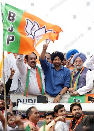 Bollywood actor and Bharatiya Janata Party (BJP) and Shiromani Akali Dal's (SAD) joint candidate from Gurdaspur, Sunny Deol (2-L) flashes a victory sign during an election campaign road show for Union Minister, Hardeep Puri (3-R, front), BJP-SAD candidate for the Amritsar Lok Sabha seat, in Amritsar, India, 16 May 2019. The Indian state of Punjab will go to the polls on 19 May 2019 for the seventh and last phase of the Indian general elections. India's general elections will decide the 545-member seats in the lower house of parliament.