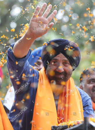 Bollywood actor and Bharatiya Janata Party (BJP) and Shiromani Akali Dal's (SAD) joint candidate from Gurdaspur, Sunny Deol gestures during an election campaign road show for Union Minister, Hardeep Puri (unseen), BJP-SAD candidate for the Amritsar Lok Sabha seat, in Amritsar, India, 16 May 2019. The Indian state of Punjab will go to the polls on 19 May 2019 for the seventh and last phase of the Indian general elections. India's general elections will decide the 545-member seats in the lower house of parliament.
