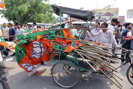 An Indian man carries Bharatiya Janata Party (BJP) flags on a rickshaw during an election campaign  road show by Bollywood actor and Shiromani Akali Dal's (SAD) joint candidate from Gurdaspur, Sunny Deol (unseen), in Amritsar, India, 16 May 2019. The Indian state of Punjab will go to the polls on 19 May 2019 for the seventh and last phase of the Indian general elections. India's general elections will decide the 545-member seats in the lower house of parliament.