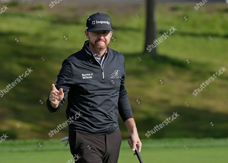 Jimmy Walker reacts after sinking a putt on the third green during the first round of the PGA Championship golf tournament, at Bethpage Black in Farmingdale, N.Y
