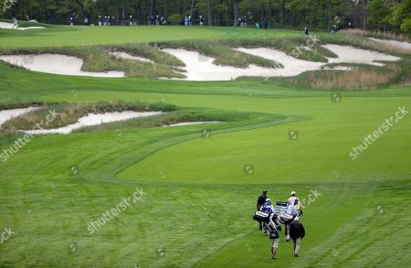 J.T. Poston, Jason Dufner and Jimmy Walker walk up the fourth fairway during the first round of the PGA Championship golf tournament, at Bethpage Black in Farmingdale, N.Y