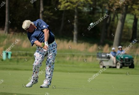 John Daly hits off the 16th fairway during the first round of the PGA Championship golf tournament, at Bethpage Black in Farmingdale, N.Y