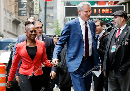 """Bill deBlasio, Chirlane McCray. New York Mayor Bill de Blasio and his wife Chirlane McCray arrive at """"Good Morning America"""" in New York, . De Blasio announced Thursday that he will seek the Democratic nomination for president, adding his name to an already long list of candidates itching for a chance to take on Donald Trump"""