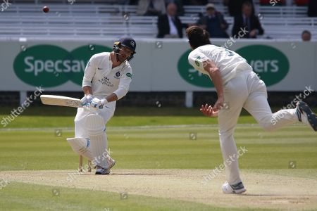 John Simpson ducks a bouncer from Chris Wright during the Specsavers County Champ Div 2 match between Middlesex County Cricket Club and Leicestershire County Cricket Club at Lord's Cricket Ground, St John's Wood