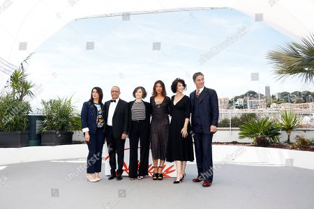 Hiam Abbass, Algerian writer Yasmina Khadra, French director Elea Gobbe-Mevellec, French actress Zita Hanrot, French director and actress Zabou Breitman and French actor Simon Abkarian pose during the photocall for 'The Swallows of Kabul' (Les Hirondelles de Kaboul) at the 72nd annual Cannes Film Festival, in Cannes, France, XX May 2019. The movie is presented in the section Un Certain Regard of the festival which runs from 14 to 25 May.