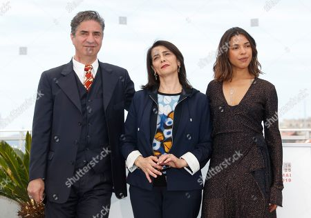 Simon Abkarian, Israeli actress and director Hiam Abbass and French actress Zita Hanrot, pose during the photocall for 'The Swallows of Kabul' (Les Hirondelles de Kaboul) at the 72nd annual Cannes Film Festival, in Cannes, France, 16 May 2019. The movie is presented in the section Un Certain Regard of the festival which runs from 14 to 25 May.