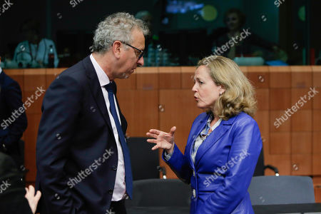 Luxembourg's Finance Minister Pierre Gramegna (L) and Spanish Minister of Economy and Business Nadia Calvino (R) at the Eurogroup finance ministers meeting at the European Council in Brussels, Belgium, 16 May 2019. The Eurogroup will exchange views on the economic situation of the euro area following  the European Commission Spring forecast published on 07 May.