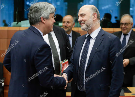 Pierre Moscovici, the European Commissioner for Economic and Financial Affairs, and Euclid Tsakalotos (L) and Eurogroup President Portuguese Finance Minister Mario Centeno (R) talk at the Eurogroup finance ministers meeting at the European Council in Brussels, Belgium, 16 May 2019. The Eurogroup will exchange views on the economic situation of the euro area following  the European Commission Spring forecast published on 7 May.