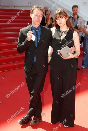 Stock Image of Bertrand Bonello (L) and Adile David (R) arrive for the screening of 'Atlantics' (Atlantique) during the 72nd annual Cannes Film Festival, in Cannes, France, 16 May 2019. The movie is presented in the Official Competition of the festival which runs from 14 to 25 May.