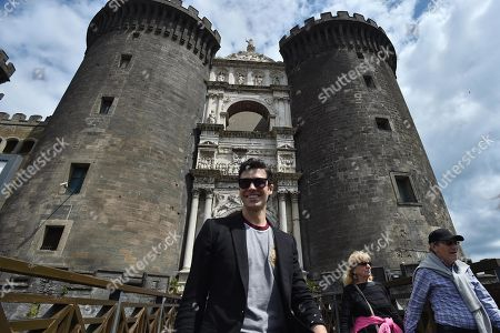 Italian dancer Roberto Bolle walks in front of Castel Nuovo after the press conference for the event 'OnDance' in Naples, Italy, 16 May 2019.