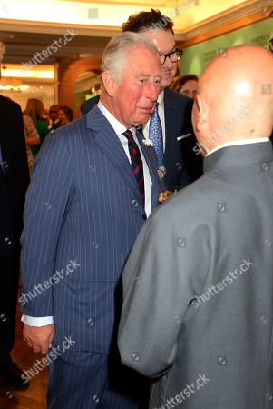 Stock Photo of Prince Charles, Prince Charles speaks to Ken Hom at the Fortnum & Mason Food and Drink Awards at the Diamond Jubilee Tea Salon in the Piccadilly flagship store.
