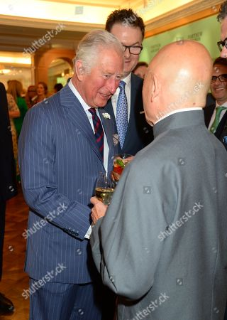 Prince Charles, Prince Charles speaks to Ken Hom at the Fortnum & Mason Food and Drink Awards at the Diamond Jubilee Tea Salon in the Piccadilly flagship store.