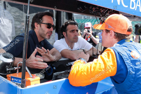 Scott Dixon, Jimmy Johnson, Dario Franchitti. Scott Dixon, of New Zealand, talks with NASCAR driver Jimmy Johnson, left, and three-time Indy 500 champion Dario Franchitti, center, during practice for the Indianapolis 500 IndyCar auto race at Indianapolis Motor Speedway, in Indianapolis