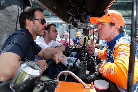 Scott Dixon, Jimmy Johnson, Dario Franchitti. Scott Dixon, right, of New Zealand, talks with NASCAR driver Jimmy Johnson, left, and three-time Indy 500 champion Dario Franchitti, center, during practice for the Indianapolis 500 IndyCar auto race at Indianapolis Motor Speedway, in Indianapolis