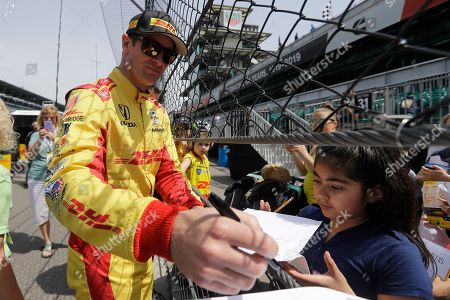 Ryan Hunter-Reay signs autographs during practice for the Indianapolis 500 IndyCar auto race at Indianapolis Motor Speedway, in Indianapolis