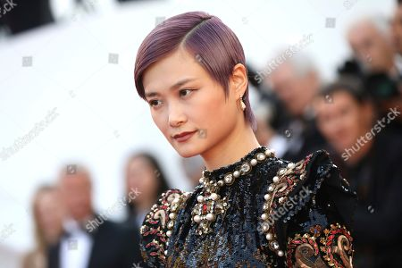 Li Yuchun poses for photographers upon arrival at the premiere of the film 'Rocketman' at the 72nd international film festival, Cannes, southern France