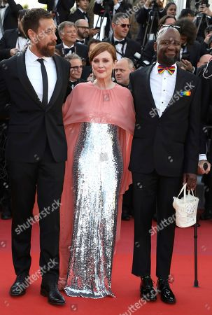 Steve Williams, Julianne Moore and Dan Krauss. Dan Krauss, from left, Julianne Moore, and Steve Williams pose for photographers upon arrival at the screening of the film '5B' at the 72nd international film festival, Cannes, southern France