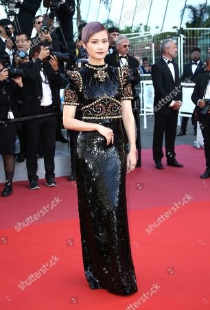 Li Yuchun, Chris Lee. Singer Li Yuchun poses for photographers upon arrival at the premiere of the film 'Rocketman' at the 72nd international film festival, Cannes, southern France