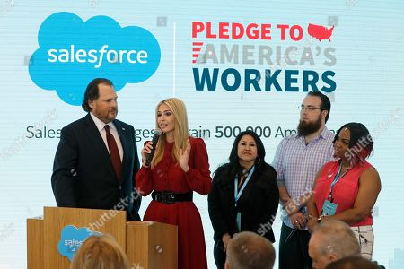 Salesforce chairman Marc Benioff, left, and Ivanka Trump speak during a news conference, in Indianapolis. Business software company Salesforce says it aims to provide skills training to 500,000 people as part of a Trump administration push to boost career opportunities among Americans