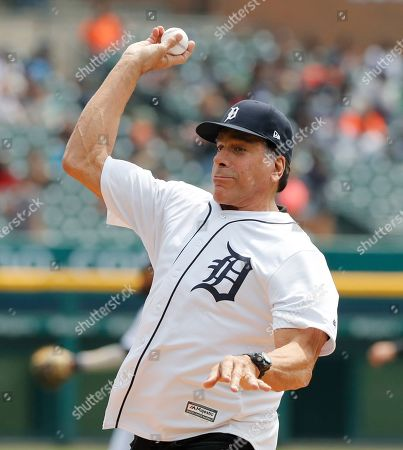 Actor Lou Ferrigno throws out the ceremonial first pitch before a baseball game between the Detroit Tigers and the Oakland Athletics, in Detroit