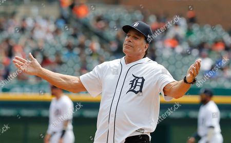 Actor Lou Ferrigno reacts after throwing out the ceremonial first pitch before a baseball game between the Detroit Tigers and the Oakland Athletics, in Detroit