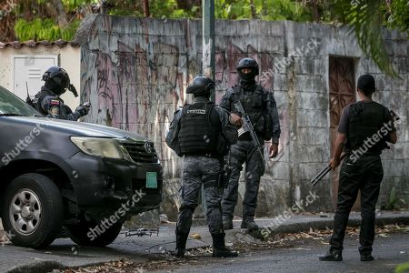 Agents of the Bolivarian Intelligence Service (Sebin) guard the surroundings of the house of former police commissioner Ivan Simonovis, in Caracas, Venezuela, 16 May 2019. Venezuelan National Assembly President Juan Guaido assured that Simonovis was freed from his house arrest after having received the same pardon he gave to opposition leader Leopoldo Lopez past 30 April.