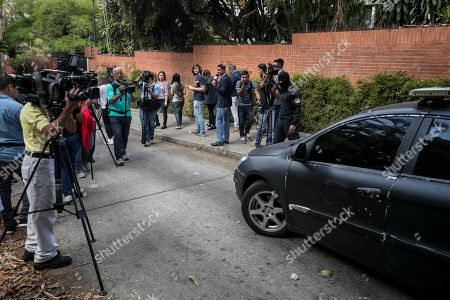 Members of the media work at the surroundings of the house of former police commissioner Ivan Simonovis, in Caracas, Venezuela, 16 May 2019. Venezuelan National Assembly President Juan Guaido assured that Simonovis was freed from his house arrest after having received the same pardon he gave to opposition leader Leopoldo Lopez past 30 April.