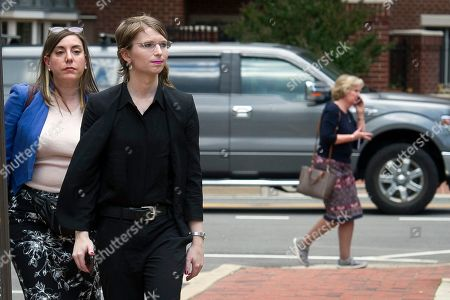 Former Army intelligence analyst Chelsea Manning wlaks with her attorney Moira Meltzer-Cohen, as they walk to the federal court, in Alexandria, Va., . Manning is at the Court to appear before a Grand Jury investigating WikiLeaks