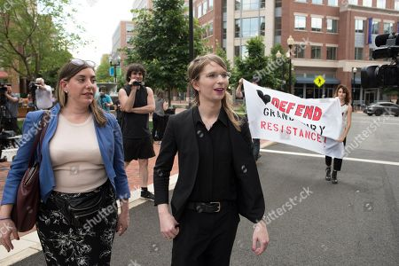 Former Army intelligence analyst Chelsea Manning walks with her attorney Moira Meltzer-Cohen, to federal court, in Alexandria, Va