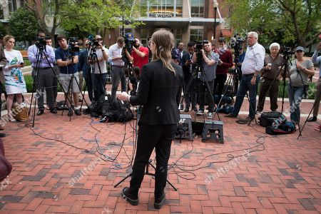 Former Army intelligence analyst Chelsea Manning speaks with reporters, after arriving at the federal courthouse in Alexandria, Va., . Manning spoke about the federal court's continued attempts to compel her to testify in front of a grand jury