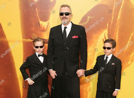 Stock Photo of Miguel Bose and his sons Diego and Tadeo