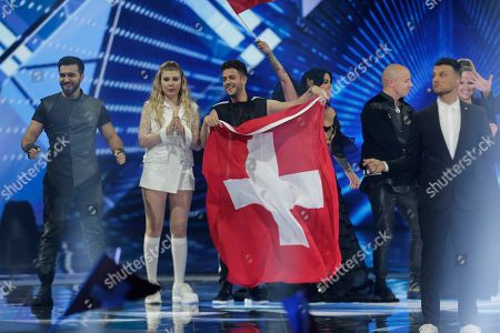 Contestant Luca Haenni of Switzerland (3-L) along with other finalists, stand on stage after the second Semi-Final of the 64th annual Eurovision Song Contest (ESC) at the Expo Tel Aviv, in Tel Aviv, Israel, 16 May 2019. The Grand Final will be held on 18 May.