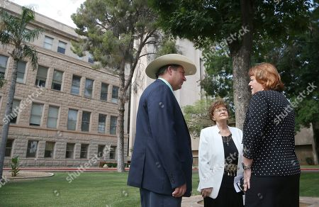 Arizona state Rep. David Cook R-Globe, left, and Rep. Gail Griffin, R-Hereford, middle, talk with farmer Tiffany Shedd, right, after a news conference at the Arizona Capitol, in Phoenix. Central Arizona farmers are making a last-minute plea to state lawmakers for $20 million to dig wells and build canals as they prepare to lose access to Colorado River water