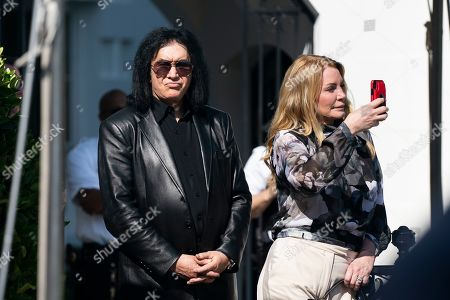 Stock Picture of Former rocker Gene Simmons (L) and his wife Shannon Tweed (R) watch US President Donald J. Trump depart the White House for New York City in Washington, DC, USA, 16 May 2019.