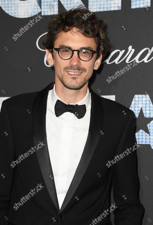 Stock Picture of Hugo Gelin poses for photographers upon arrival at the party for the film Rocketman at the 72nd international film festival, Cannes, southern France