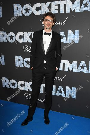Stock Photo of Hugo Gelin poses for photographers upon arrival at the party for the film Rocketman at the 72nd international film festival, Cannes, southern France